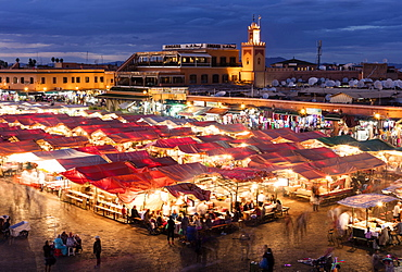 View over the Djemaa el Fna at dusk showing food stalls and shops, Marrakech, Morocco, North Africa, Africa