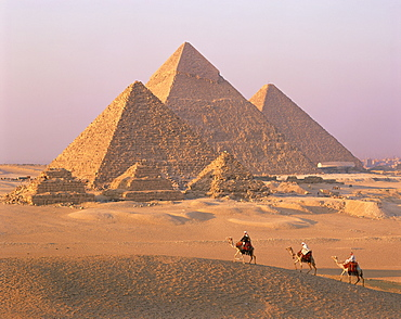 Camel riders at Giza Pyramids, UNESCO World Heritage Site, Giza, Cairo, Egypt, North Africa, Africa