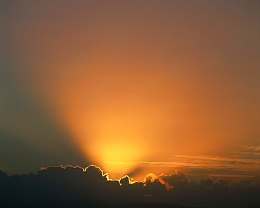 Rays of light bursting out of dark clouds