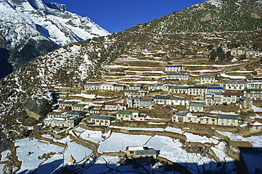 Houses and terraced fields under snow at Namche Bazaar in the Himalayas in Nepal, Asia