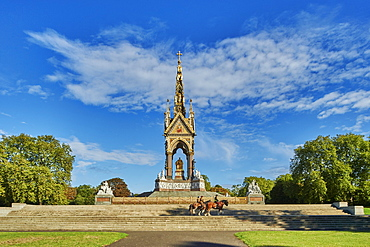 Three heavy horses are ridden past The Albert Memorial, Kensington Gardens, Hyde Park, London, England, United Kingdom, Europe