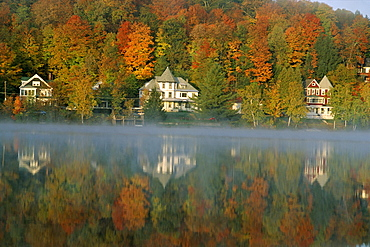 Large houses beside Lake Flower at Saranac Lake Town in early morning, Adirondack area, New York State, United States of America (U.S.A.), North America