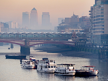 Canary Wharf partially obscured by river mist behind Blackfriars Bridge, London, England, United Kingdom, Europe