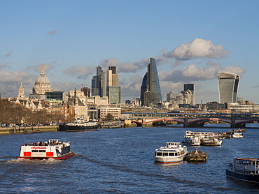 Classic cityscape across Blackfriars Bridge shows City CBD and St. Pauls Cathedral, London, England, United Kingdom, Europe