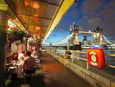 Terrace restaurant and Tower Bridge at dusk, London, England, United Kingdom, Europe