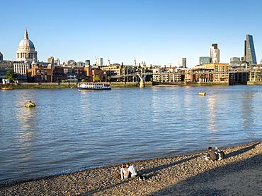 St. Pauls and City skyline, beach beside the River Thames, London, England, United Kingdom, Europe