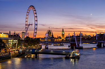 Millenium Wheel (London Eye) with Big Ben on the skyline beyond at sunset, London, England, United Kingdom, Europe