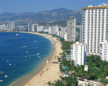 The beach and high rise buildings at the resort of Acapulco, Mexico, North America