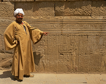 Temple guide with a detail of relief carving including hieroglyphics, Kom Ombo, Egypt, North Africa, Africa