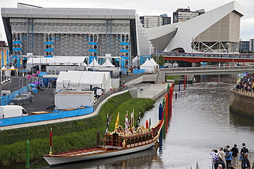 View of the Royal Barge Gloriana showing the Aquatics Centre and Water Polo Arena in the background, Olympic Park, Stratford, London, England, United Kingdom, Europe