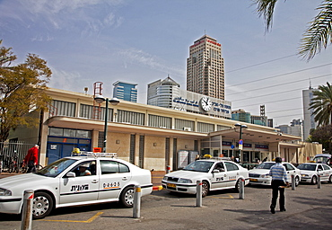 Taxi rank outside the Tel Aviv train station showing the Leonardo City Tower Hotel in distance, Tel Aviv, Israel, Middle East