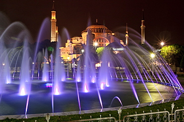 Coloured fountains at night in Sultan Ahmet Park, a favourite gathering place for locals and tourists, looking towards the Blue Mosque, Istanbul, Turkey, Europe