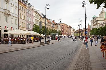 Cobbled Old Town Krakowskie Przedmiescie Street and street cafes, Warsaw, Poland, Europe