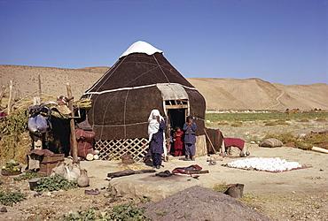 Uzbeki family outside yurt, near Maymana, Afghanistan, Asia