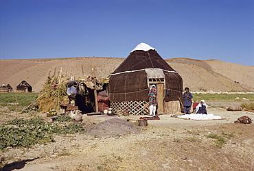 Uzbeki tribespeople outside yurt, near Maymana, Afghanistan, Asia