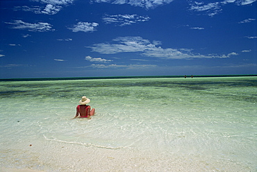Woman in the sea on the beach at Cayo Coco on the island of Cuba, West Indies, Central America