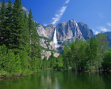 The Merced River swollen by summer snowmelt, with the Yosemite Falls in the background, in the Yosemite National Park, UNESCO World Heritage Site, California, United States of America, North America