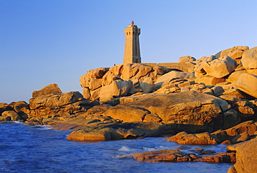 Lighthouse and pink granite rocks at sunset, Ploumanach, Cotes d'Armor, Brittany, France, Europe