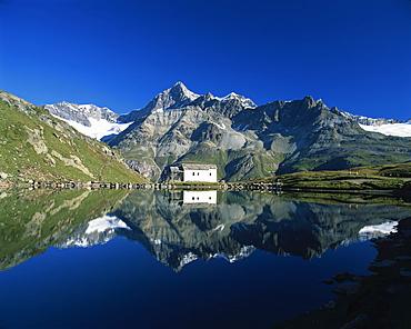 White chapel and Ober Gabelhorn reflected in the Schwarzsee, Zermatt, Valais, Switzerland, Europe