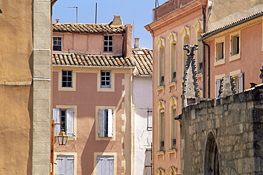Pastel coloured facades in the Rue Droite, Narbonne, Aude, Languedoc-Roussillon, France, Europe