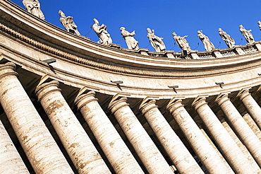 Gian Lorenzo Bernini's 17th century colonnade and statues of saints, Piazza San Pietro, St. Peter's, Vatican City, Rome, Lazio, Italy, Europe
