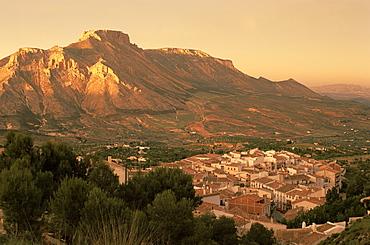 Velez Blanco nestled beneath the rocky peak of La Muela at sunset, Almeria, Andalusia (Andalucia), Spain, Europe
