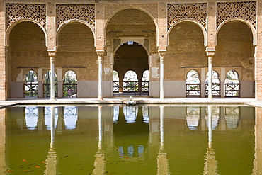 Portico of the Torre de las Damas reflected in tranquil pool, Jardines del Partal, Alhambra, UNESCO World Heritage Site, Granada, Andalucia (Andalusia), Spain, Europe - 390-2719