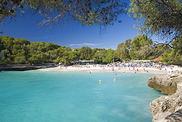 View across the turquoise waters of Cala Mondrago, Parc Natural de Mondrago, near Portopetro, Mallorca, Balearic Islands, Spain, Mediterranean, Europe