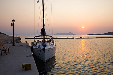 View across the harbour at sunrise, Frikes, Ithaca (Ithaki), Ionian Islands, Greece