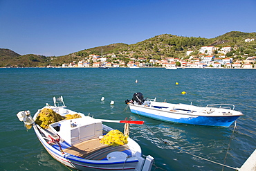 View across the harbour, colourful fishing boat in foreground, Vathy (Vathi), Ithaca (Ithaki), Ionian Islands, Greek Islands, Greece, Europe