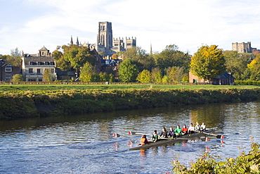 View across the River Wear to Durham Cathedral, female college rowers in training, Durham, County Durham, England, United Kingdom, Europe