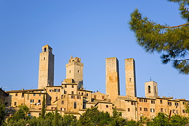 Medieval towers lit by the rising sun, San Gimignano, UNESCO World Heritage Site, Siena, Tuscany, Italy, Europe
