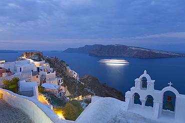 Illuminated cruise ship entering the caldera at dawn, Oia (Ia), Santorini (Thira) (Thera), Cyclades Islands, South Aegean, Greek Islands, Greece, Europe,