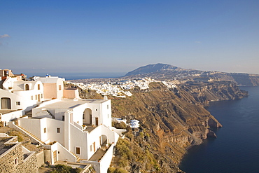 View along volcanic cliffs towards distant Fira, Imerovigli, Santorini (Thira) (Thera), Cyclades Islands, South Aegean, Greek Islands, Greece, Europe