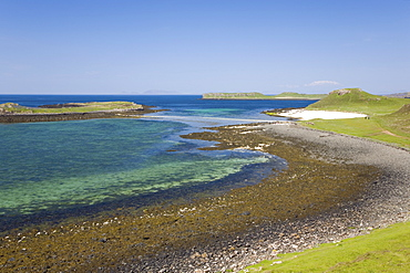 View over shore at low tide to distant Coral Beach, Claigan, near Dunvegan, Isle of Skye, Inner Hebrides, Highland, Scotland, United Kingdom, Europe