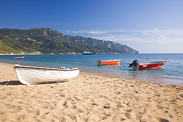 View from the beach to distant Cape Taxiarhis, Agios Georgios, Corfu, Ionian Islands, Greek Islands, Greece, Europe