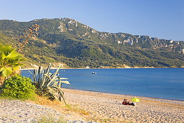 View across the bay to wooded hillside, early evening, Agios Georgios, Corfu, Ionian Islands, Greek Islands, Greece, Europe