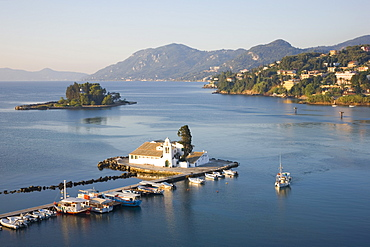 View to the Monastery of Panagia Vlacherna, small boat approaching, Kanoni, Corfu Town, Corfu, Ionian Islands, Greek Islands, Greece, Europe