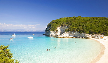 View across the clear turquoise waters of Vrika Bay, Antipaxos, Paxi, Corfu, Ionian Islands, Greek Islands, Greece, Europe