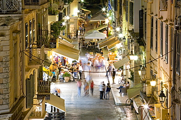 View by night over illuminated Odos Kapodistriou, Corfu Town, Corfu, Ionian Islands, Greek Islands, Greece, Europe