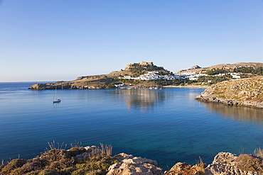 View across the tranquil waters of Lindos Bay, Lindos, Rhodes, Dodecanese Islands, South Aegean, Greece, Europe