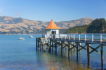 Daly's Wharf, an historic jetty overlooking Akaroa Harbour, Akaroa, Banks Peninsula, Canterbury, South Island, New Zealand, Pacific
