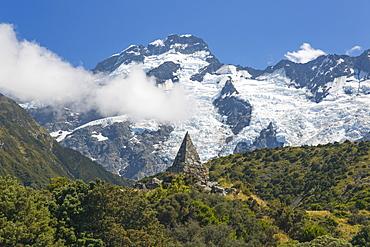 Alpine memorial dwarfed by Mount Sefton, Aoraki (Mount Cook National Park, UNESCO World Heritage Site, Mackenzie district, Canterbury, South Island, New Zealand, Pacific