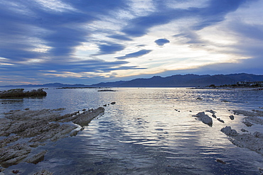 View across the tranquil waters of South Bay at dusk, Kaikoura, Canterbury, South Island, New Zealand, Pacific