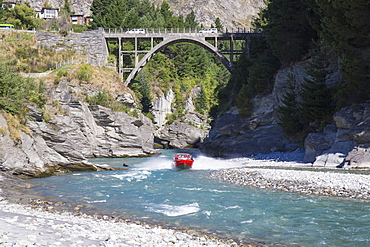 Jet boat on the Shotover River below the Edith Cavell Bridge, Queenstown, Queenstown-Lakes district, Otago, South Island, New Zealand, Pacific