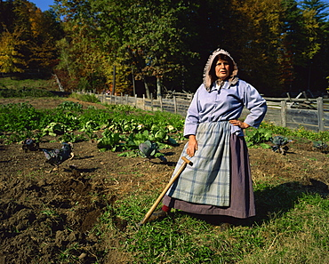 Hoeing the vegetable garden, recreated New England village life between 1790 and 1840, Old Sturbridge Village, Massachusetts, New England, United States of America, North America