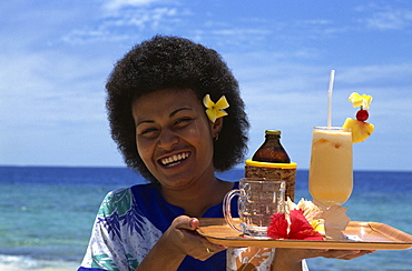 Waitress with fruit cocktail, Navini Island, Fiji, Pacific Islands, Pacific - 395-54