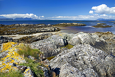 West coast of the Scottish Highlands looking west towards the Small Isles with Eigg and Rhum on the far left and the Isle of Skye to the right on the horizon, Scotland, United Kingdom, Europe