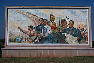 Photograph taken in the 1960s of a billboard showing the four modernizations, represented by farmer, scientist, industrial worker holding complete works of Mao and soldier, Shaoshan, Hunan, China, Asia
