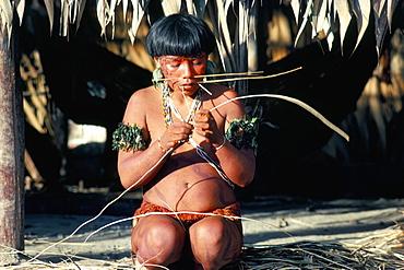 Yanomami with vine for basket making, Brazil, South America